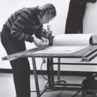 An art student making a print