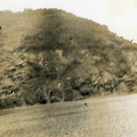 A damaged photo of nature and a road