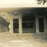 A building with pillars and tiled roof
