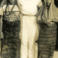 Three women pose for a photograph