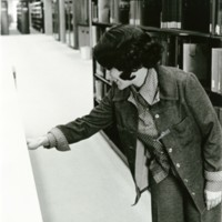 A woman looking through the reference materials