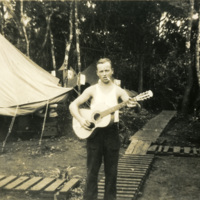 A soldier plays guitar