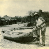 A soldier poses with a canoe
