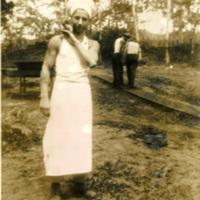 A soldier in a chef's attire