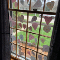 Hearts in the window of a home in Mount Pleasant, Wisconsin