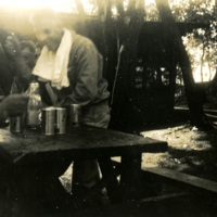 Soldiers seated at a table