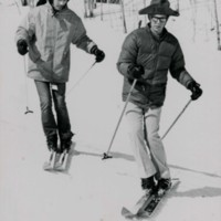 Students skiing down a hill