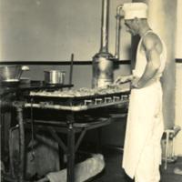 A cook preparing food