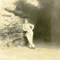 A soldier leans against a rock