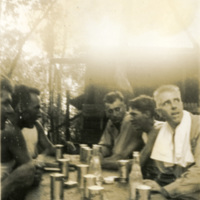 Soldiers sharing drinks