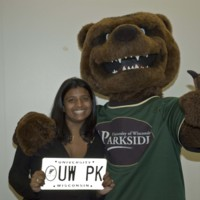 Ranger Bear posing with a student