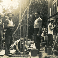 Soldiers working on a building site
