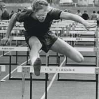 Student jumping hurdles