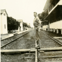 A soldier stands by train tracks