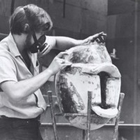 An art student making a sculpture