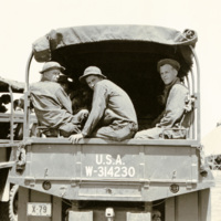 Soldiers in the back of a truck