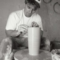 Student using a potter's wheel