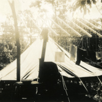 A tent surrounded by construction