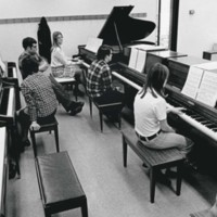 Students practicing piano