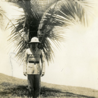 A uniformed soldier poses for a photograph