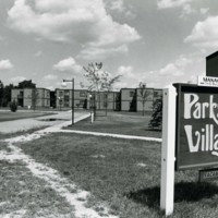 Parkside Village seen from the south with sign