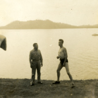 Two soldiers by the water