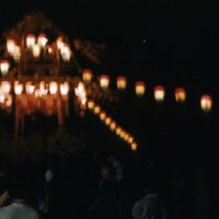 Lanterns over a crowded street at night