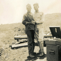 Two soldiers dancing next to a record player