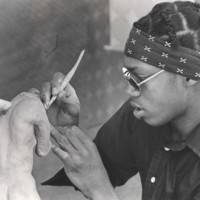 A student works on a sculpture