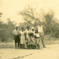 A group of people and a soldier