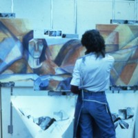 Student working on a painting