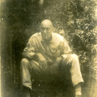 A soldier seated for a photograph