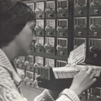 A person uses the card catalog