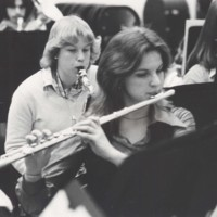 A flutist plays as part of a band performance