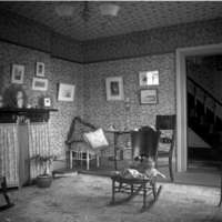 Parlor with a cat sitting on a chair, H.M. Baldwin house, 321 Chicago Street