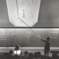 Professor using overhead projector