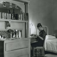 Student studies in dorm room