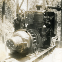 A picture of two soldiers standing beside a machine