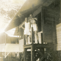 Two soldiers stand outside a building