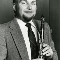 Tim Bell posing with a clarinet