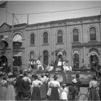 Parade float in front of North-Western Loan & Trust Company