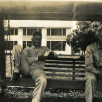 Soldiers seated on a bench