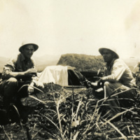 Two soldiers drinking beverages