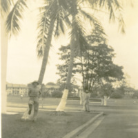 A soldier leans against a tree