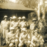 A group of uniformed soldiers with rifles in their hands