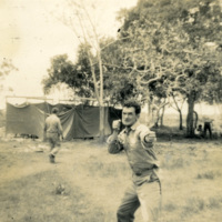 A soldier strikes a humorous pose