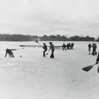 Students playing broom ball on Lake Wyllie