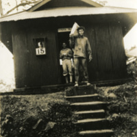 Two soldiers standing by a doorway