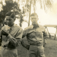 Two soldiers pose for a photograph