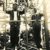 Two soldiers standing in a building frame